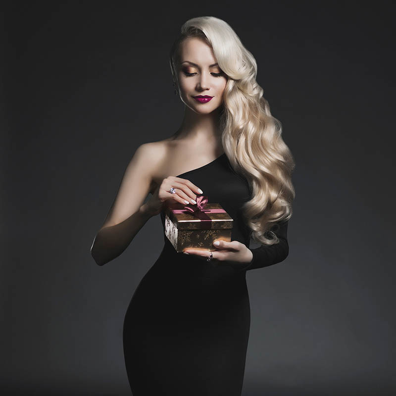 Fashion photo of luxury blonde with Christmas gift